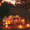 Outdoor dining under the stars at Chobe Under Canvas